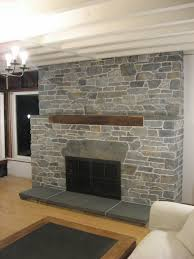 living room large stone fireplace