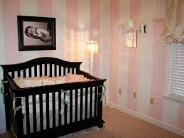 decorations small baby girl nursery room ideas with corner decorative lighting and brown wood baby baby room lighting ideas