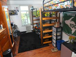chic design ideas of college dorm with black metal bunk bed and colorful bedding sheets also chic design dorm room ideas