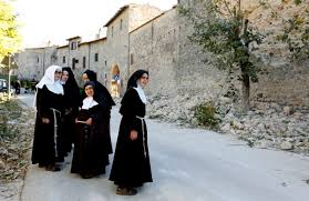 photos central struck by strongest earthquake in decades nuns stand next a partially collapsed wall following an earthquake in norcia