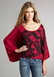 لمسات اللون الأحمر تزيدكِ جمالاً images?q=tbn:ANd9GcR