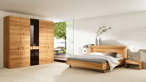 simple bedroom design for couple with wooden modern bed and wardrobe bedroom simple modern bedroom design