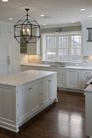 beautiful white kitchen cabinets: dark floorswhite cabinets white granite silver knobs and gray paint wall beautiful kitchen window like this look need help with a renovation can do