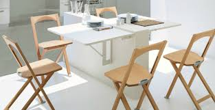 very small modern dining room design with double wall mounted drop leaf dining table with 4 wood folding chairs and all white furniture and wall interior all white furniture design