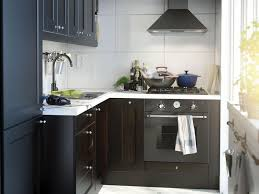 budget kitchen ideas small terrific small kitchen design with white wooden cabinets ideas plus colorful apron decoration ideas also old blue dining table affordable kitchen furniture