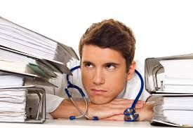 Doctor surrounded by paper files