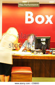 female customer is buying tickets from theatre box office in west end stock image art deco box office loew