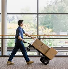 commercial office moving services optimum moving nj young man moving boxes