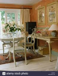 Cottage Dining Room Table White Painted Table And Chairs In Peach Cottage Dining Room With