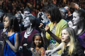 u s department of defense photo essay michelle obama wife of president elect barack obama along her daughters a