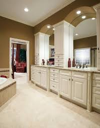 traditional style antique white bathroom: beautiful traditional bathroom with aristokraft cabinets nantucket door style thermofoil in antique paint
