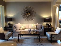 warm living room ideas: simple and warm living room design idea with beige pastel colored walls dark brown wood rectangle side coffee tables white ivory fabric cushion sofa beige
