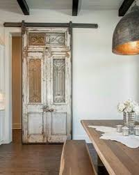 mac cave visual for ceiling and dramatizing beams the lights but in kitchen over dining room table too white antiqued french doors on dining area amelie distressed chandelier perfect lighting