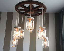 custom made wheel mason jar chandelier alternating length wagon wheel mason jar