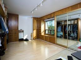bedroom winsome closet: big turning a bedroom into a closet featuring wooden wall clothes rack ideas and big mirror sliding door wardrobe