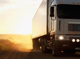 truck dispatcher job description semi truck driving on dusty dirt road