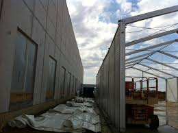 temporary warehouse structures st qtr summary industrial notice how how much light comes through the translucent roof this particular structure was removed from an oil field services company site in co