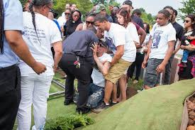 a man is shot in the back and only the police are kept in the mourning mr maldonado during his interment at rosedale rosehill cemetery in linden n j credit Ángel franco the new york times