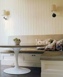 three storage drawers shape the base of this lovely little banquette in the corner with the banquette furniture with storage