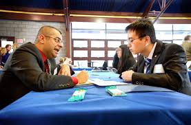 seniors practice interviewing skills in mojo workshop hamilton director of diversity and inclusion amit taneja left interviews quan wan 14 during