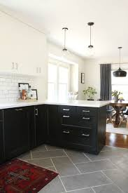 kitchen floor tiles small space: clean lines and contrasting colors make for a bold and contemporary look that can be dressed up or down with furnishings