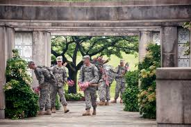 u s department of defense photo essay iers enter the columbarium to place small american flags in front of headstones during flags
