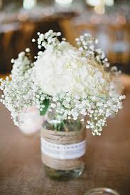 burlap lace centerpiece effortless white flowers like hydrangea and babys breath can be arranged in beautiful classic mason jar