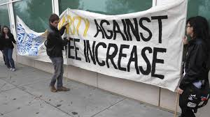 uc regents increase tuition demonstrators place a sign protesting university fee increases at uc davis monday nov