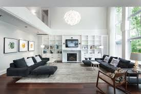 awesome contemporary living room decor ideas applying wooden flooring furnished with double black sofa beds and awesome large living room