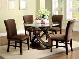 modern wood dining room sets: simple round glass dining room table symbol circle with  dark brown sofa chair above brown