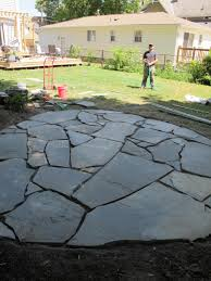 stone patio installation: how to install a flagstone patio with irregular stones diy network blog made remade diy