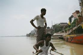 global water forum special essay the ganga eternally pure men in boat ganga