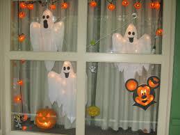 love halloween window decor: our decorated resort window for halloween at disneys port orleans riverside resort