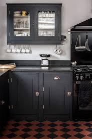 vintage apartment oozes luxury black kitchen