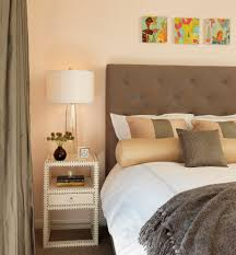 contemporary bedroom example of a trendy bedroom design in boston with beige walls and carpet cool side table awesome small bedside table