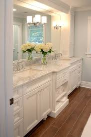 built bathroom vanity design ideas: double vanity with cabinet storage on either side lighting built into mirror lamantia design