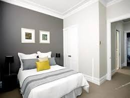 master bedroom feature wall: white walls with dark grey feature wall for the hall