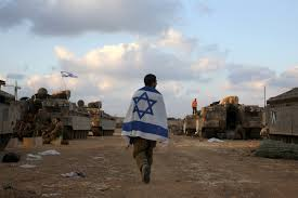jewish optimism in the face of hamas war the tower an i ier carries an i flag at a gathering point near the border gaza