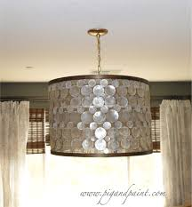 chic capiz shell chandelier with drum shade and golden holder for home interior lighting ideas chandelier ideas home interior lighting chandelier