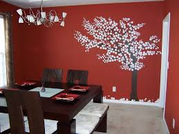 dining room wall decorating ideas: dining room wall decor ideas displaying with red wall color with tree painting of dining room wall decor completed with pendant lamps and furnished with
