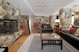 through this expansive open rustic living room design we see an all wood spiral staircase beautiful living room pillar