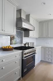 ben moore brushed aluminum gray cabinet paint light gray counters blue range blue cabinet kitchen lighting