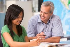 educational pursuit college essay and resume prep   educational    a teacher instructs a schoolgirl in a high school class