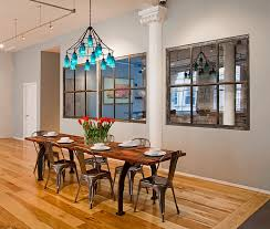 industrial style dining room with a colorful chandelier chandelier style dining room lighting