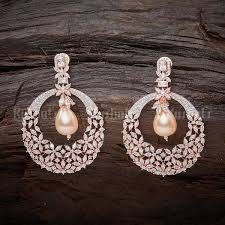 Unique design <b>zircon</b> earrings studded with white stones, pearl ...