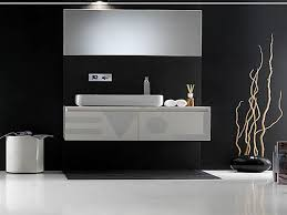 futuristic bathroom using floating bathroom sink cabinets and clear mirror on black painted wall bathroom sink furniture cabinet