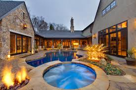 House Plans Interior Courtyards Pool Design Ideas  Remodels  amp  PhotosTraditional courtyard  form pool idea in Charlotte   natural stone pavers