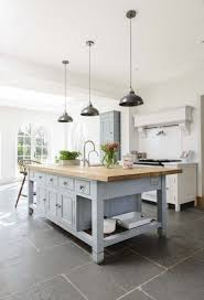 kitchen floor tiles small space: large tiles makes smaller space seem larger miranda gore brownes chalon kitchen with our worn grey limestone flooring