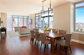 modern japanese style dining room design with wooden dining table and beig dining chairs also pendant chandelier style dining room lighting