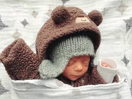 How to dress <b>baby</b> in <b>winter</b>: All your options for keeping them <b>warm</b>